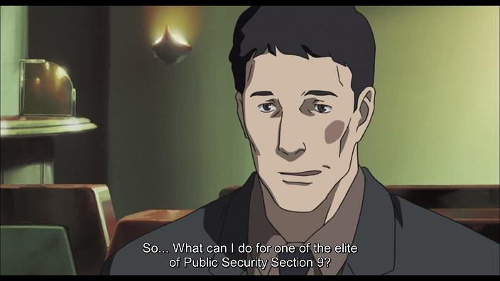 Fukami, SIU investigator talking to Togusa.